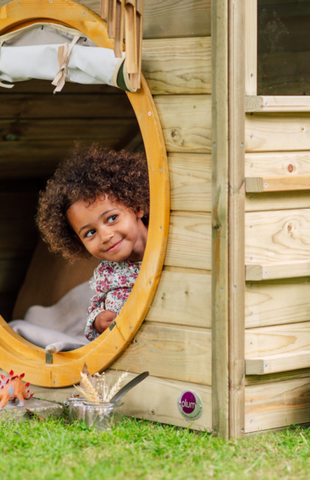 Girl outdoors in Plum Discovery Nature Play Hideaway