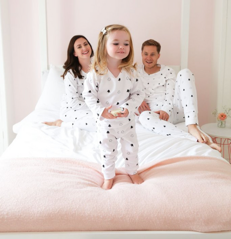 Family wearing matching christmas sleepwear by Didi and Bud