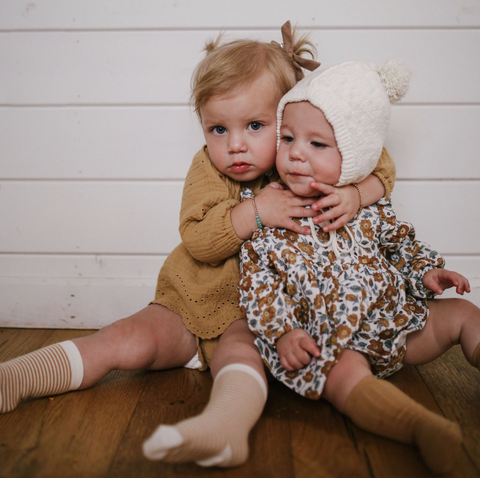 Two children wearing Sisi and Seb clothing