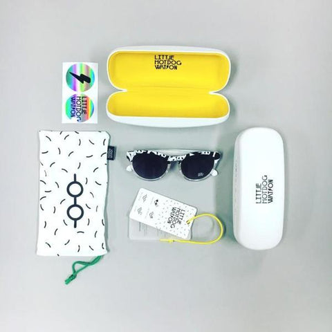 Overhead shot of sunglasses and accessories by LHW as featured on little hotdog watson blog