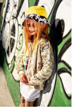Little Hotdog Watson girl wearing sun hat from the Hooligans Magazine shoot