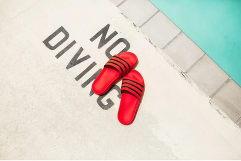 Red slider sandals by the pool