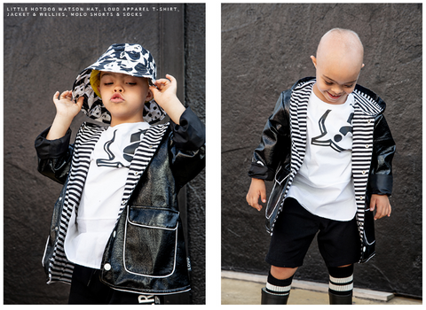 Little Boy wearing all monochrome including panda sun hat