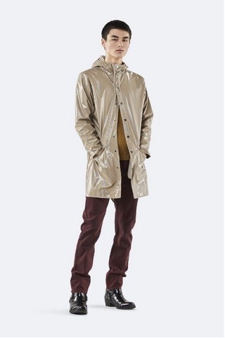 Man wearing beige holographic raincoat