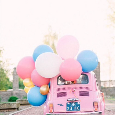 Pink car full of balloons for fun car journeys with Kids on the Little Hotdog Watson blog