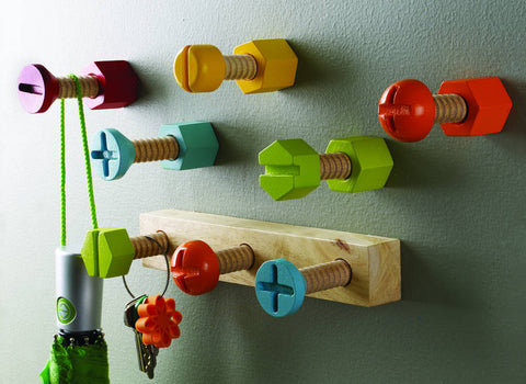 Brightly coloured wooden screw shaped clothes hooks as featured on Little Hotdog Watson blog