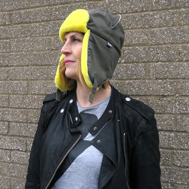 Women wearing Watson Trapper hat with ear flaps down