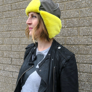 Women wearing Watson winter hat in Khaki with yellow faux fur trim