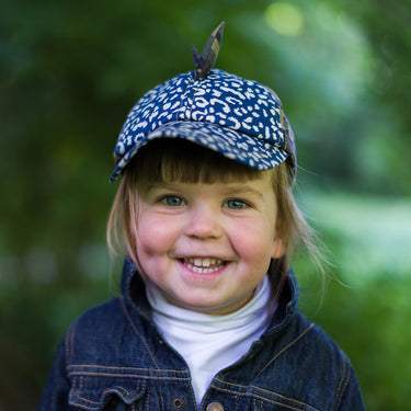 Child wearing Little Hotdog Watson kids baseball cap sun hat in leopardtude