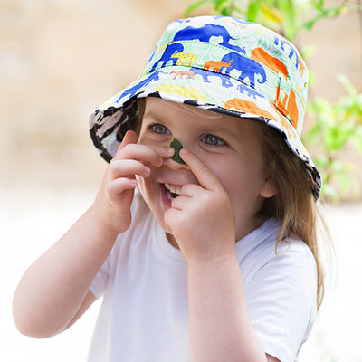 Girl wearing bucket sun hat with elephant print on it from Little Hotdog Watson