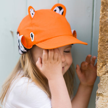 Girl wearing orange sun hat by Little Hotdog Watson