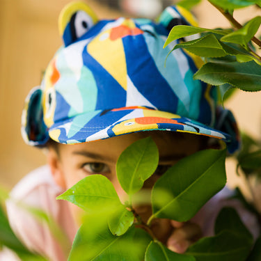 Child wearing toucan print kids sunhat