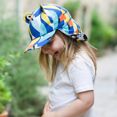 Toddler wearing blue sun hat with neck flap by Little Hotdog Watson