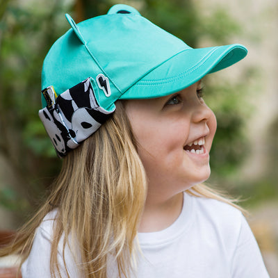 Child wearing turquoise kids sunhat
