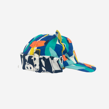 Side view of kids baseball sun hat with soft peak in Toucan Play print