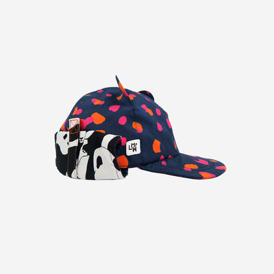 Side view of adults navy sun hat with neck flap rolled up from Little Hotdog Watson