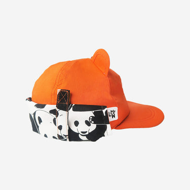 Side view of adults sun hat with neck flap from Little Hotdog Watson in orange