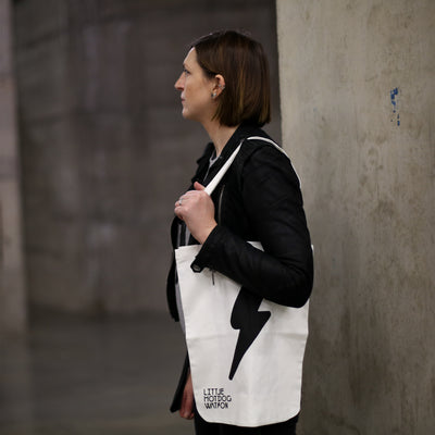 Woman carrying Little Hotdog Watson's white 'go bag'