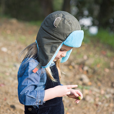 Child wearing khaki trapper hat from Little Hotdog Watson