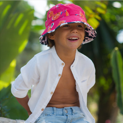 Child wearing cool kids pink hippo print Adventurer bucket hat