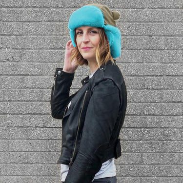 Women wearing Watson winter hat in Khaki with turquoise faux fur trim