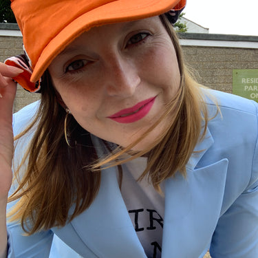 Woman wearing orange adults sun hat with neck flap