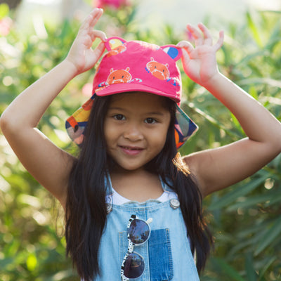 Lifestyle shot of Little Hotdog Watson's kid cub sunhat in Hip Pink