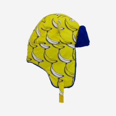 flat lay of winter hat with banana print