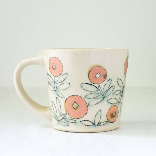 Modern Coffee Mug with Blue and Pink Floral Design