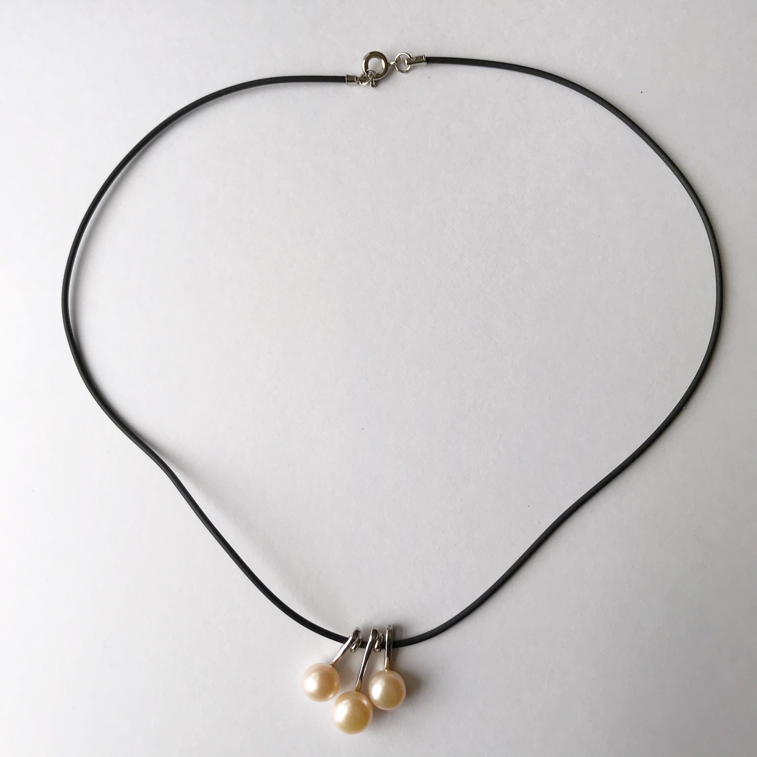 3 pearl necklace on a leather cord  necklace - Stylish n Trendier