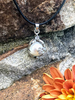 Load image into Gallery viewer, Single real pearl on black leather cord - The Lotus Wave