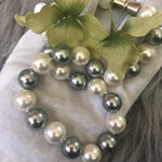 Load image into Gallery viewer, Mother of pearl round cream and grey necklace - The Lotus Wave