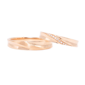 18 carat rose-gold sculpted wedding band set