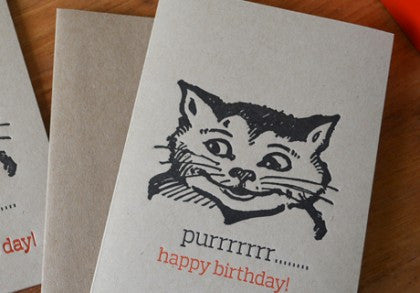 Grinning birthday cat