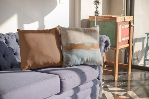 Blue and brown throw pillows
