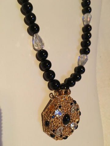 Beautiful Black and Clear Beaded Necklace with Gold Focal Point