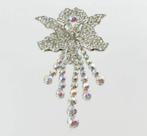 Silver base floral brooch with cascading stones