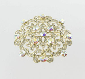 Clear scoll design crystal broach