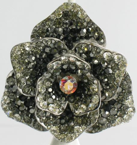 silver base brooch with black stones
