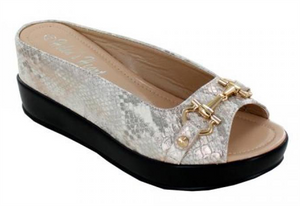 Snake Skin Wedges Cream snake textured casual hidden wedge casual shoe with bit top.