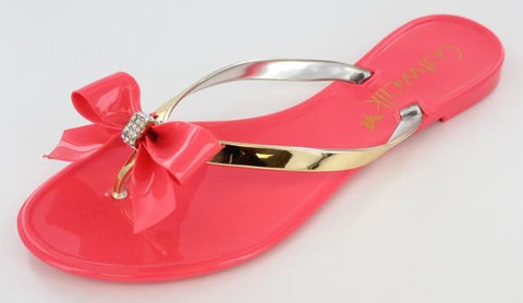 Coral jelly with gold strap and bow accent
