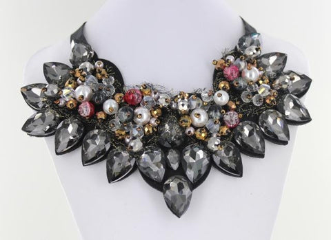 Black and Pearl Bib style necklace adorned with mixed metals and colorful beads.