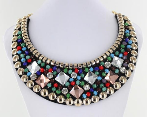 Blue, GReen and Red Bib style necklace adorned with mixed metals and colorful beads.