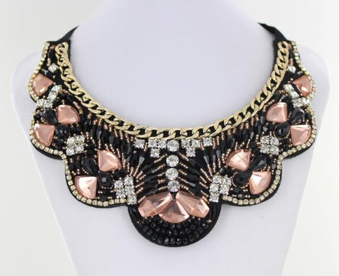 PInk and Black Bib style necklace adorned with mixed metals and colorful beads.