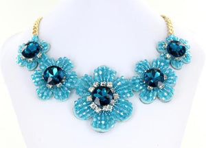 Blue Bib style necklace adorned with mixed metals and colorful beads.