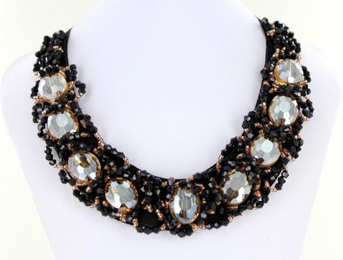Black and Clear Bib style necklace adorned with mixed metals and colorful beads