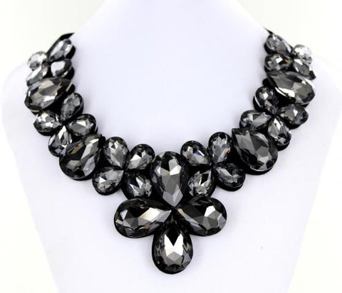 Black Bib style necklace adorned with mixed metals and colorful beads.
