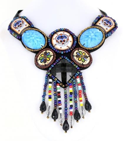 Blue Bib style necklace adorned with mixed metals and colorful beads