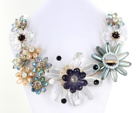 Flowerd Clear Bib style necklace adorned with mixed metals and colorful beads