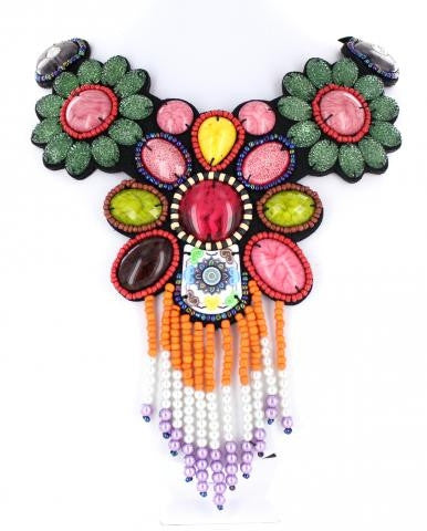 Bib style necklace adorned with mixed metals and colorful beads.